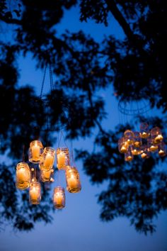 Love, love, love this! Magical way to transform a rustic wedding using candles in hanging mason jars!