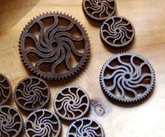Wooden gears of assorted sizes with a unique swirl pattern.