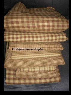 Thinking about using brown checkered quilts on the sitting part of the sectional couch to break up all the dark brown. Love these!