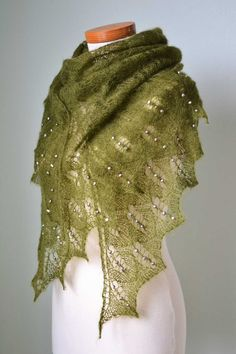 Lace knit shawl with freshwater pearls by Berniolie (same pattern as my brown shawl - interesting to see the difference in texture and look with different yarn and beads) - wonder how she can afford to sell at that price considering how much the pearls and yarn must have cost?