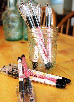 Great way to put my contact info on a pen for my 31 parties! I am making these! Take basic ball point pens with clear casings…and pretty them up with bits of scrap paper that you roll up and tuck inside!
