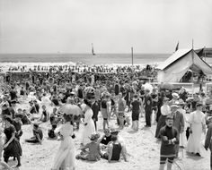 """Circa 1910. """"Atlantic City, N.J. -- the bathing hour."""" Nattily attired in a variety of suits. 8x10 inch glass negative, Detroit Publishing Co."""