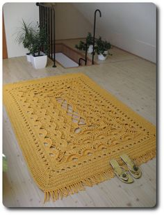 A new yellow crocheted carpet, 140x190 cm.