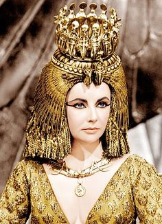 Cleopatra was the last pharaoh of Ancient Egypt. Her romantic liaisons and military alliances, as well as her exotic beauty and powers of seduction, earned her an enduring place in history. She was portrayed by Elizabeth Taylor in the 1963 film Cleopatra. Elizabeth Taylor Cleopatra, Film Elizabeth, Elizabeth Taylor Jewelry, Queen Elizabeth, Cleopatra Costume, Egyptian Costume, Egyptian Makeup, Edward Wilding, Patricia Kelly
