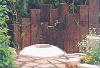 Railroad Ties in staggered heights to make outdoor wall