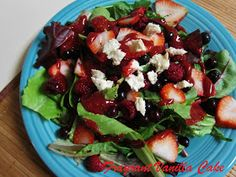 Fancy and yum!  Triple Berry Salad with Macadamia Chevre and Raspberry Chia Dressing