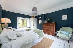 Hague blue bedroom with green upholstery