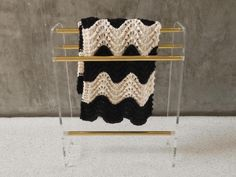 Lucite and brass blanket rack