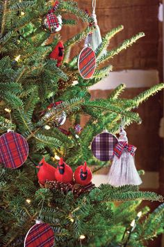 Memorable Christmas Tree - Scottish Open House Decorating Projects - Southernliving. Make your tree memorable by using only five favorite ornaments. Silver tassels, reminiscent of a horse's mane, are finished with double knots of plaid. Red birds hunker down in cozy nests, and shiny bells lure kids of all ages to give a little jingle. Two types of wooden crafts store disks, some covered with Royal Stewart and others with Gordon Dress plaid paper, take the place of traditional glass balls. St