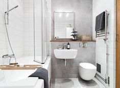 Nice use of space on the wall with toilet, sink, drying rack, and mirror