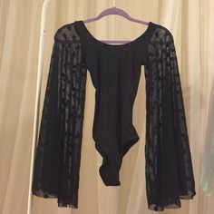 Black Milk Bodysuit NWOT New without tags by black milk clothing. Sold out. Blackmilk Tops