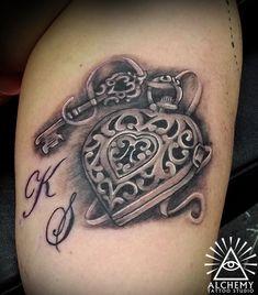 Heart locket and key tattoo, grand children's initials . artist Miss C Tattoos Melbourne