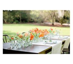 Using colors you eventually choose, multiple small vases as one centerpiece idea
