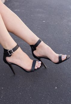Ladylike and elegant! These Giovanna Heels in black scream just that, and so much more. Features an open-toe style with single strap, ankle strap with side buckle closure. Heel cup. Cushioned heel, ru