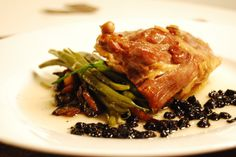 Duck Confit on string beans and mushrooms with a red wine and blueberry reduction. Find the recipe here: http://awaytoawomansheart.blogspot.no/2012/02/valentines-dinner-n2.html