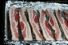 How To Cook Bacon in the Oven - this is a keeper!  the bacon cooked perfectly and the no mess clean up was a bonus!  UPDATE - I started baking them on a cooling rack to drain off the fat - its even better!! the bacon gets much crispier :)