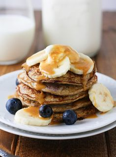 Super easy, healthy and low calorie pancakes made with banana and fresh blueberries. Perfect kick start to a clean morning! | itscheatdayeveryday.com