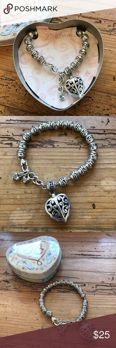 """Brighton heart bracelet with tin box bead dangle Fits 7.5"""" - 8"""" wrist. Needs to be cleaned but otherwise great. The beads move throughout the bracelet. Super cute! Check out my other Brighton items!  Bundle and save! Brighton Jewelry Bracelets"""