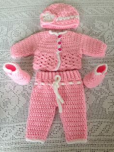 A personal favorite from my Etsy shop https://www.etsy.com/listing/221668691/baby-booties-baby-cardigan-baby-crochet