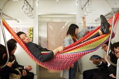 Japan Trends: http://www.japantrends.com/napping-train-seat-japan-hammock-futon-carriage/