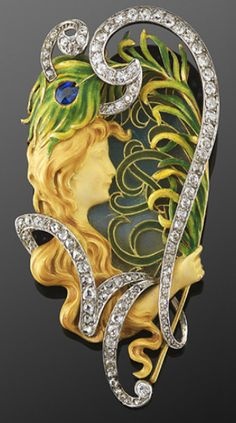 An Art Nouveau brooch by Louis Aucoc. A diamond-set scroll frames   A diamond-set scroll with a total of approximately 2.20 carats diamondsan enameled maiden holding a peacock feather against a plique a jour enamel background, set in 18 karat yellow gold and platinum.