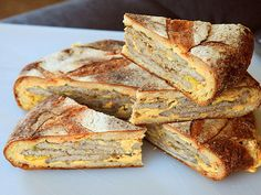 A Shooter's sandwich consists of a hollowed out sourdough loaf that has been filled with the meats and cheese of choice and then pressed overnight until it can be sliced like a pie.