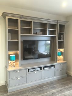 Framed, Hand-Painted TV Unit by Enigma Design.
