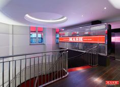 The latest photographs of MASH London. The helical staircase at the entrance leading down to the restaurant Facebook Competition, Latest Facebook, Entrance, Neon Signs, Restaurant, London, Building, Photographs, Meal