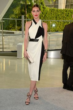 CFDA Awards Red Carpet | Hilary Rhoda was futuristic in a black and white Helmut Lang dress, while her yellow baubles added a playful twist