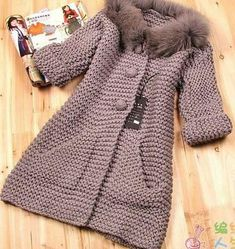 Knitting Patterns Coat Moda 'Beautiful taupe knitted coat in garter stitch' Crochet Baby Jacket, Crochet Coat, Knitted Coat, Knit Jacket, Crochet Cardigan, Crochet Clothes, Knitting For Kids, Baby Knitting Patterns, Crochet Pattern