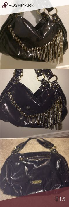 """Candice Los Angeles patent fringe bag Candice Los Angeles patent fringe bag. Large bag with a lot of space. Zip pocket on the front and back, inside zip pocket, 2 other pockets. Normal wear. Smoke and pet free home. Size 12""""x15"""". The color is dark purple candise Los Angeles Bags"""