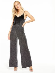 V by Very Metallic Wide Leg Trouser Wow the crowd in V by Very'ssparkling wide leg trouser. These metallic flares twinkleand glisten with silvery thread, while the high waist and wide leg inject 70s vibes, channeling the disco decade. Styling Ideas Wear with a slinky bodysuit and shimmering shoes to shine bright this party season.