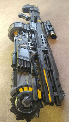 Nerf longshot painted gray with an 8 kg spring upgrade. Permanantly combined with a nerf brainsaw. Sci Fi Weapons, Concept Weapons, Weapons Guns, Fantasy Weapons, Guns And Ammo, Rifles, Arsenal, Nerf Longshot, Pistola Nerf