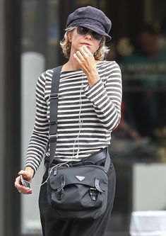 Meg Ryan Photos - Actress Meg Ryan chats on her cellphone while taking a walk through Soho in New York City, NY. - Meg Ryan Chatting On Her Phone In New York City