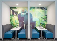 """The booth area located near the open work space and adjacent to the breakroom was designed to provide an inspirational """"moment"""" that captured both the brand and personality of Gorilla Logic, as well as provide a multi-functional area that could serve as meeting space, break space, or independent work space. The custom wallcovering, printed from an artist's work out of London, captures the brand colors and boldness of the company's style. Corporate Interior Design, Corporate Interiors, Break Room, Personality, Inspirational, London, Space, Printed, Colors"""