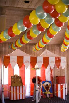 Balloon idea. Save money on helium and string them upside down.