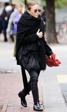 Mary-Kate Olsen black scarf, jacket fur, skinny jeans flat ankle boots