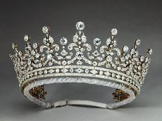 Queen Elizabeth still wears this beauty frequently today. It came from Princess Victoria Mary of Teck (later Queen Mary), who received The Girls of Great Britain Tiara as a wedding present; she once wore it to an 1897 ball to complement her French Renaissance-period costume.  love lace leopard <3