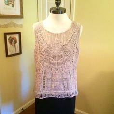 Tan Crocheted Sweater Tank This is a beautiful tan colored crocheted tank top in a size large. Sleeveless. Solid knit back. Adiva Tops Tank Tops