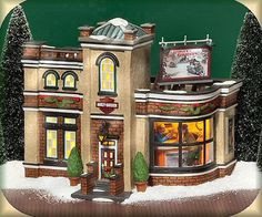 """Harley-Davidson Detailing, Parts And Service"" Dept. 56 Christmas In The City Item #59214. Introduced 2003 and retired 2006. Includes Interior Scene. Size: 8.25"" x 6.5"" x 6.25""."