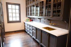 dark cabinets, gold sink