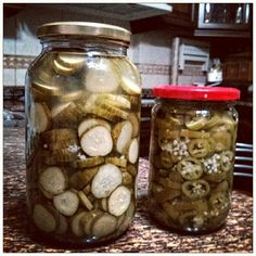 Sliced cucumbers and jalapeños pickles  - 2 cups of water - 1 cup white vinegar - 4 tablespoons sugar - 2 tablespoons coarse salt - 3 cloves, thinly sliced garlic - 1 teaspoon oregano - Bring to boil - Remove from heat - Throw in sliced 1 kg of cucumbers or 1/2 kg of jalapeños. - Stir and leave for 5 minutes until they change color - Sanitize jars and covers with boiled water - Put cucumbers or jalapeños in jars - Wait until liquid is at room temperature and top off jars - Place in fridge…