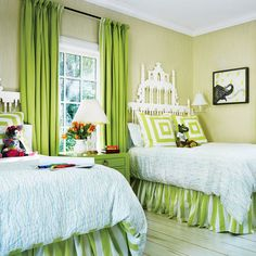 A cute kids room with bright green accents and playful geometric fabrics