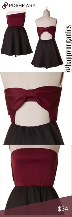 Open back Bow Skater Dress Show stopping sassy mini Strapless dress featuring an open back with bow detail. This color block dress is Burgundy and black.  measurements to be listed.. Please ask me any questions!  95% Polyester 5% Spandex Made in USA Naturally Spiritual Dresses