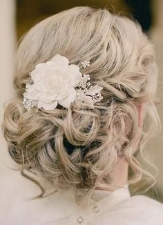 I like this up-but-messy look. Love the look of flowers in hair.