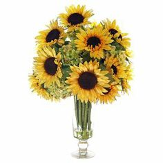 """Create a lush tablescape or charming vignette with this lovely faux sunflower and hydrangea arrangement, nestled in a clear glass vase.   Product: Faux floral arrangementConstruction Material: Silk, plastic, acrylic and glassColor: Yellow and greenFeatures: Includes faux sunflowers and hydrangeasDimensions: 26"""" H x 18"""" DiameterNote: For indoor use only"""