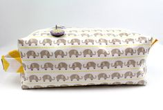 Great organizer and makes a cute present for someone special. :)  Choose your size   Small gray elephants Zipper by JanaCreations