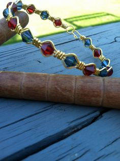 Ruby and Dark Indigo Swarovski Crystal Wire Wrapped Bracelet via Etsy only $25