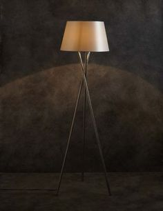 Inspired by a design classic, this metal tripod floor lamp with a tapered fabric shade will suit traditional and contemporary interiors alike.
