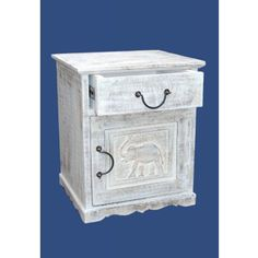 White Elephant Handcarved Bedside Cabinet - Buy Bedside Tables Online  This fantastic Mango wood hand carved white washed cabinet features 1 drawer and 1 door. Boasting a unique and lovely elephant design, this bedside cabinet is made from Indian seasoned hardwood .